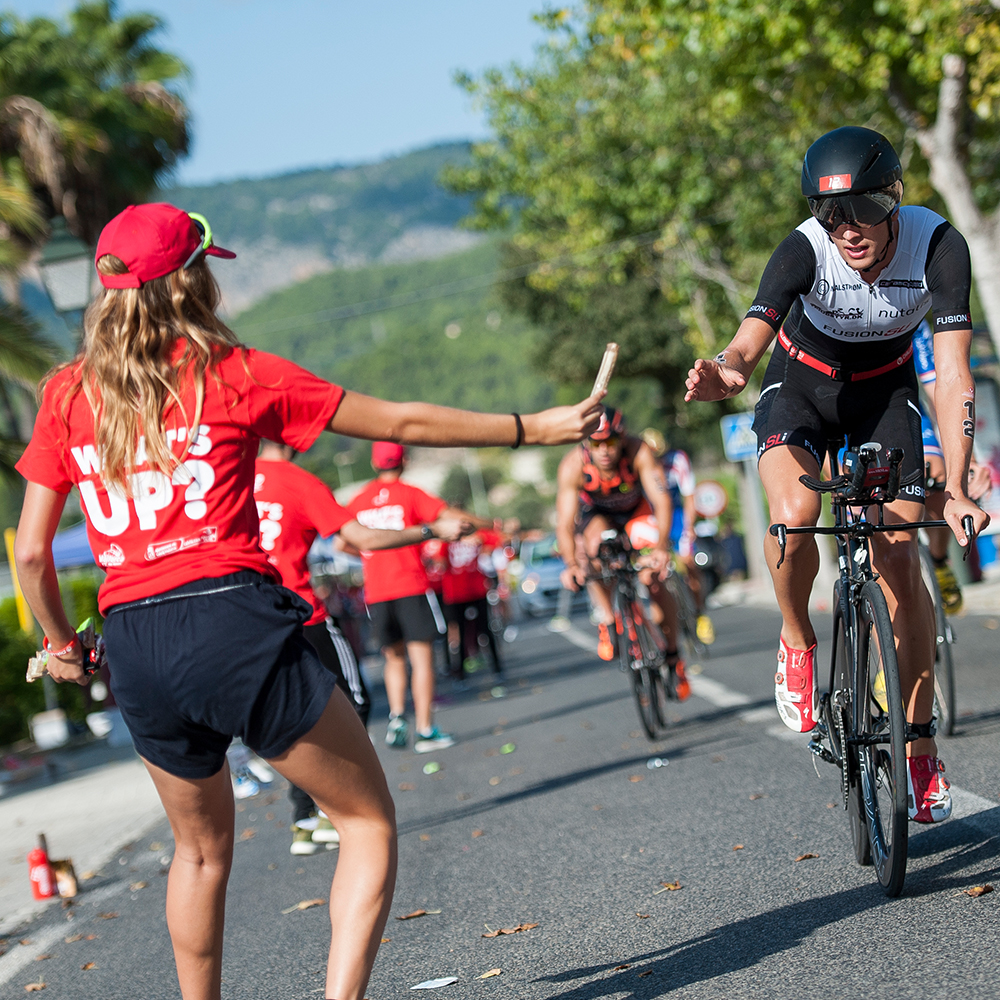 Volunteers on the aid stations Challenge Mallorca triathlon 70.3 middle distance race in Peguera mallorca Ironman 70.3